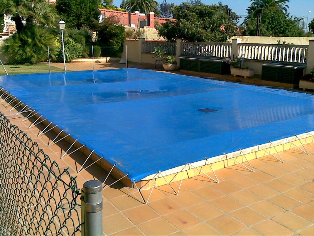 Cobertores y lonas para piscinas toldos t rrega castell n for Lona piscina redonda